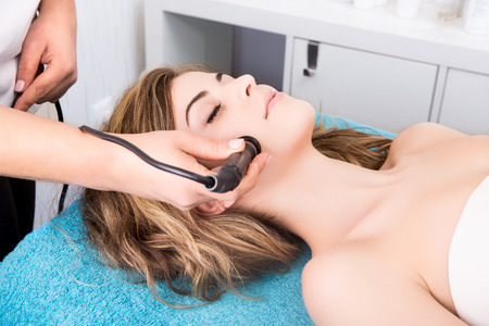 beauty treatment clinic: Woman doing cosmetic procedures in spa clinic Stock Photo