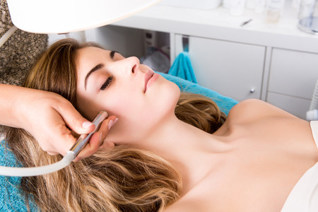 medical procedure: Woman doing cosmetic procedures in spa clinic Stock Photo