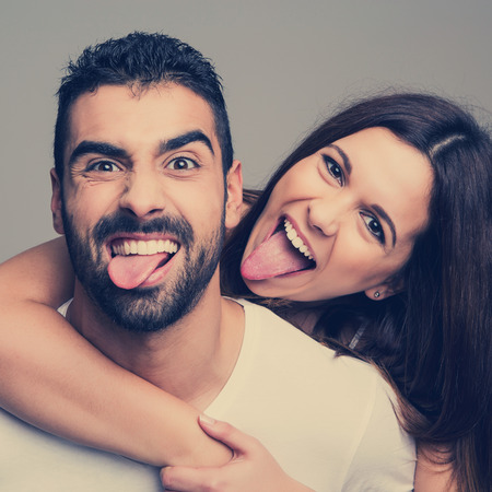 Portrait of a funny love couple hugging each other photo