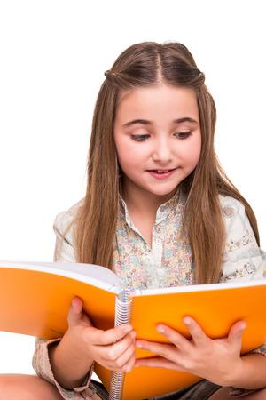 girl reading book: Little girl holding a open sketchbook over white  Stock Photo