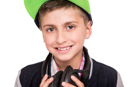 withe background: Little boy holding headphones over withe background