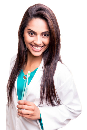 dental mirror: Female dentist doctor showing dental mirror and toothbrush