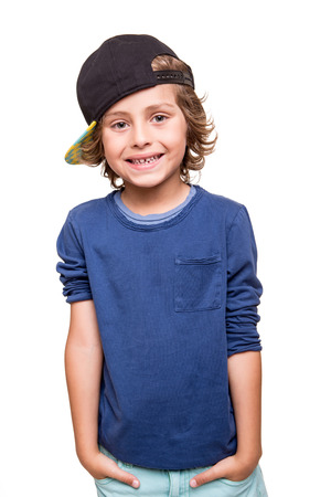 Cool young boy posing over white background