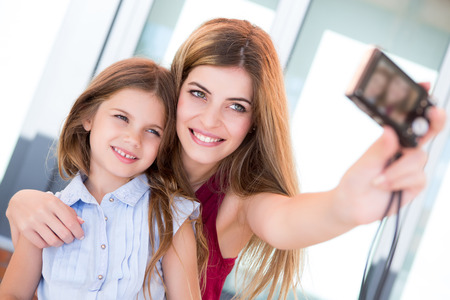 take a smile: Girl taking a selfie with her mother or sister Stock Photo