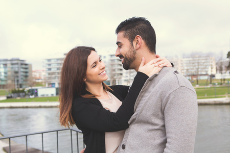 love in rain: Lovely couple hugging each other in the city Stock Photo