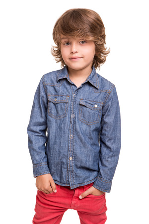 Cute blonde boy posing over white Stock Photo - 31264889