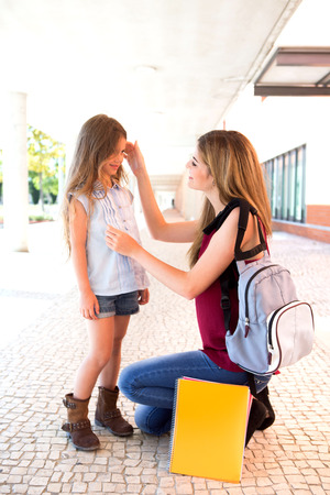 goodbye: Mother saying goodbye to her daughter at shool Stock Photo