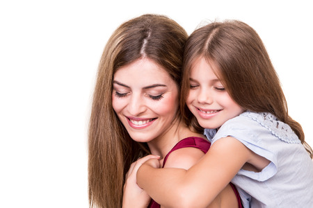 2 years old: Beautiful portrait of hugging mother and daughter