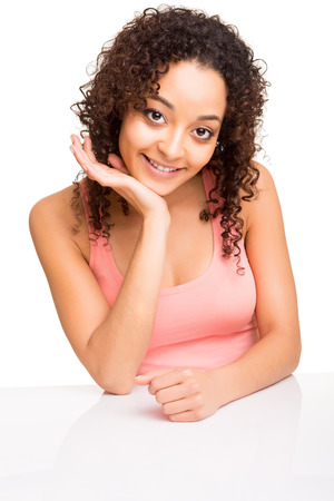 afro girl: Cute afro girl posing on a table over white background