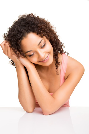 afro girl: Cute afro girl thinking on a table over white background