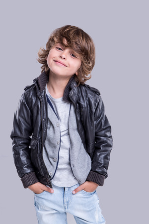 Fashion little boy wearing a leather jacket Stock Photo
