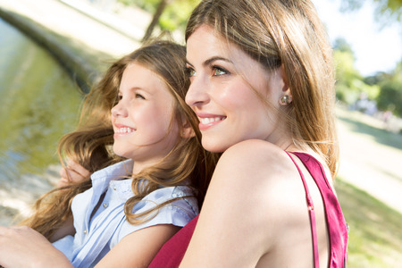 Mother and daughter relaxing in the city park photo