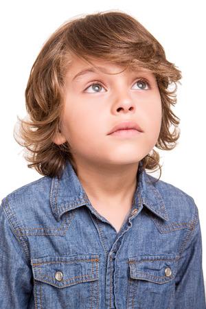 blond boy: Cute blond boy thinking over white background Stock Photo