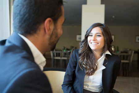 couple talking: Young business couple meeting with digital tablet Stock Photo