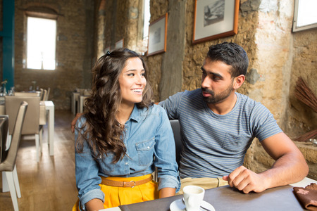 Young couple talking in restaurant and cafe photo
