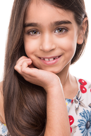 south american: Little cute latin girl posing over white background