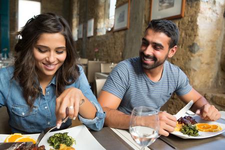 Couple having lunch at rustic gourmet restaurant Foto de archivo