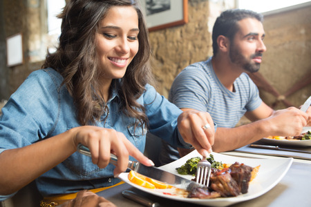 restaurant people: Couple having lunch at rustic gourmet restaurant Stock Photo