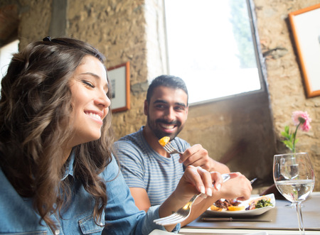 Couple having lunch at rustic gourmet restaurant Stock Photo
