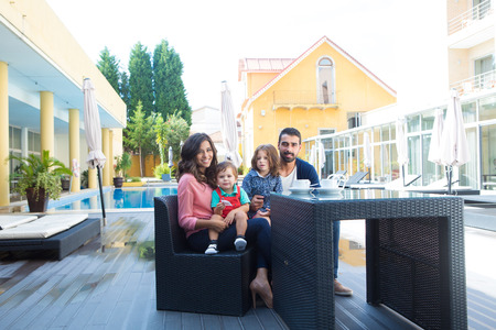 latin family: Beautiful latin family relaxing close to the pool