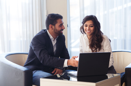 latin: Young business couple meeting with tech devices Stock Photo