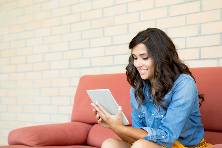 Fashion woman using tablet with lens flare photo