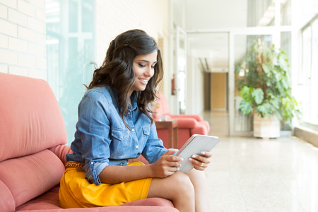 business communication: Fashion woman using tablet with lens flare