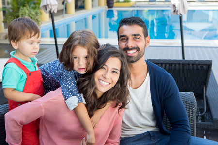 hispanic americans: Beautiful latin family relaxing close to the pool