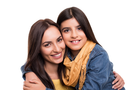 hispanic students: Woman and little girl hugging each other - Family concept Stock Photo