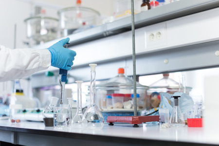 pharmacy technician: Chemical scientist working in modern biological laboratory