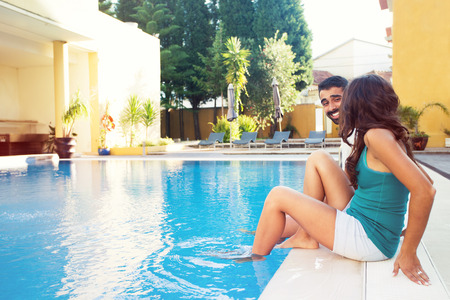 Beautiful couple having fun in swimming pool photo