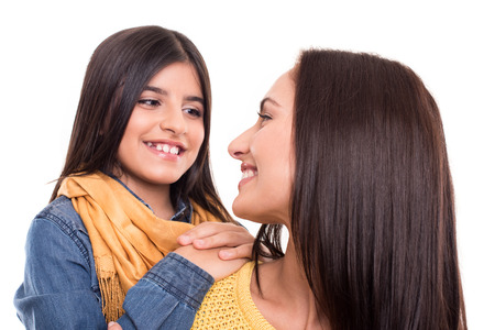 concep: Woman and little girl hugging each other - Family concep