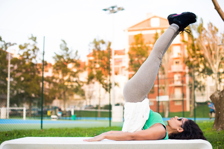 Fitness woman doing exercises in the city park photo