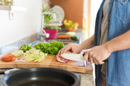 nutricion: Detail of man in kitchen cooking healthy lunch Stock Photo