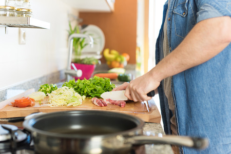 Detail of man in kitchen cooking healthy lunch Stock Photo