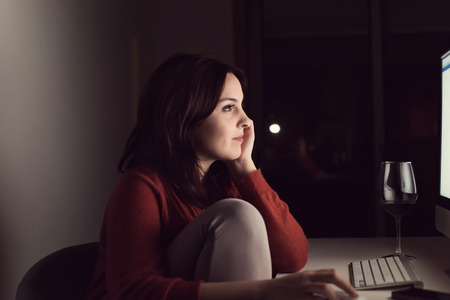 Woman watching online videos on desktop