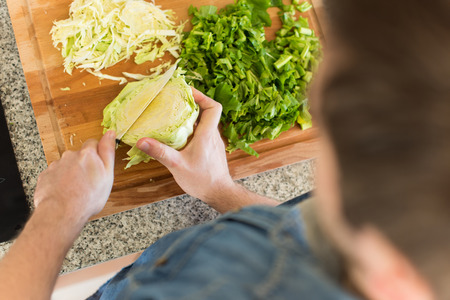 nutricion: Point of view of man cooking vegetables