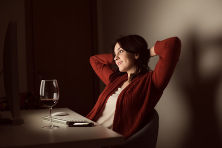 video call: Woman in video call with a glass of wine on hand