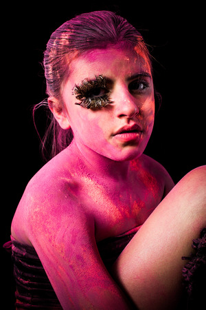 colored powder: Girl with colored powder exploding around her