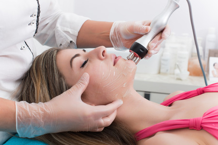 clinics: Woman doing cosmetic procedures in spa clinic Stock Photo