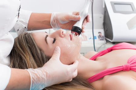 aesthetic: Woman doing cosmetic procedures in spa clinic Stock Photo