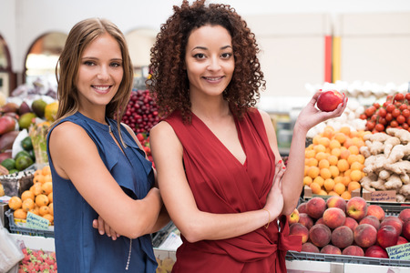Business women presenting their organic greengrocer photo