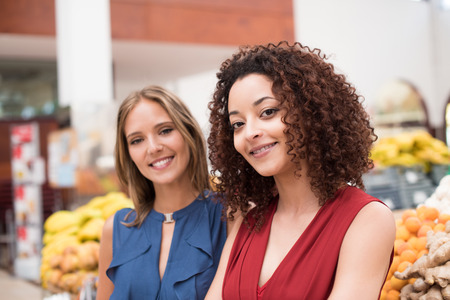costumer: Business women presenting their organic greengrocer Stock Photo