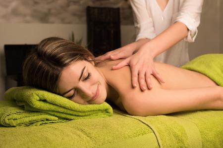 beauty center: Woman having a back massage in spa beauty center Stock Photo