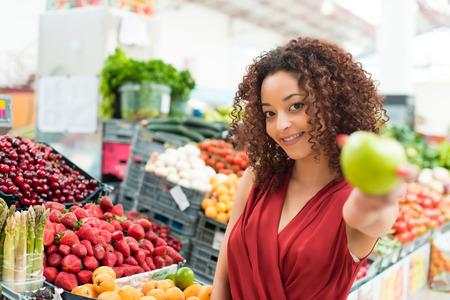 local: Afro woman shopping organic veggies and fruits