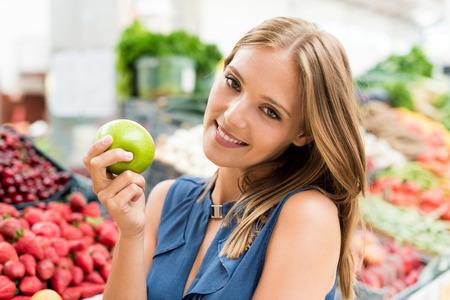 Blonde woman shopping organic veggies and fruits photo