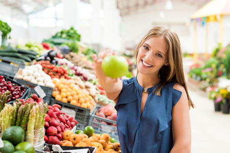 Blonde woman shopping organic veggies and fruits