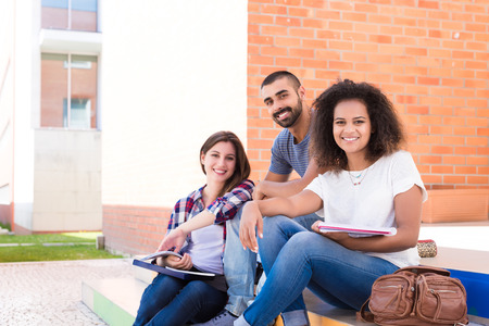 hispanic students: Group of students sitting on school stairs