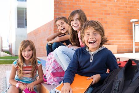 cute little girl: Group of happy little school kids in school