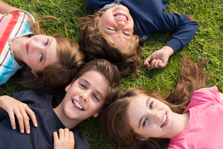 Group of little kids lying on grass